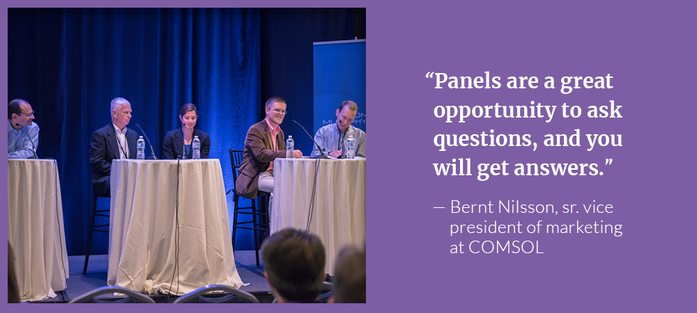 A photograph from a panel discussion on simulating batteries and fuel cells.