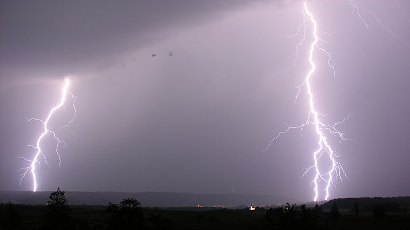 A photograph of lightning strikes in the sky.