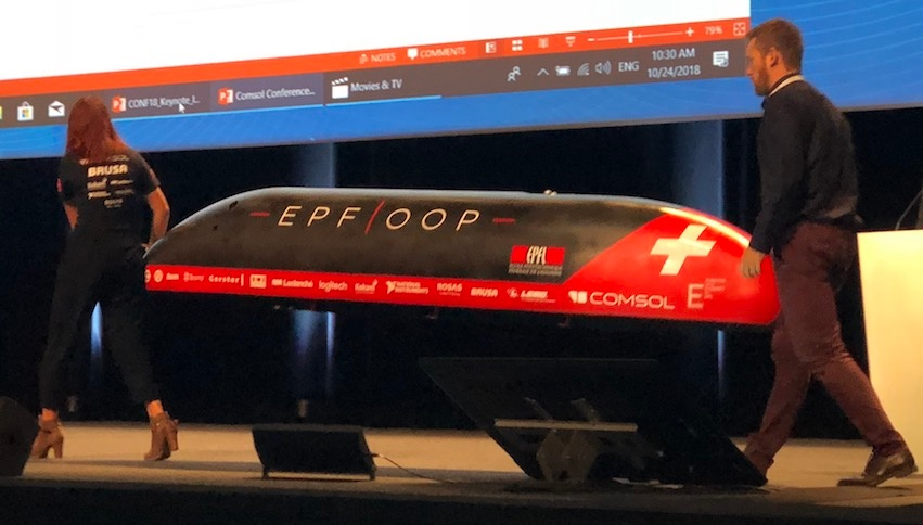 A photograph of EPFLoop team members with their hyperloop pod design.