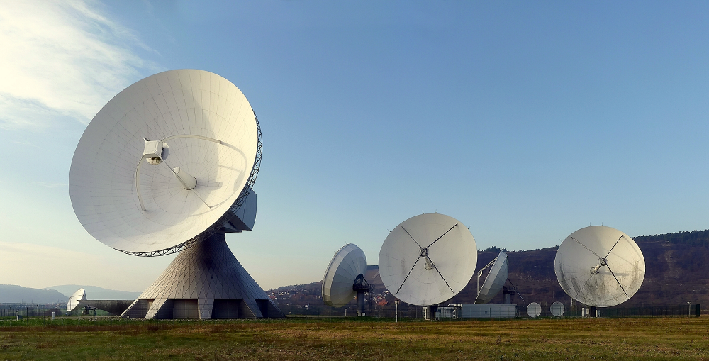 A photograph of a group of large dish antennas.
