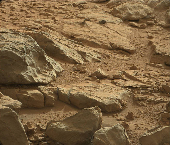 A close-up view of rocks and sand on Mars.