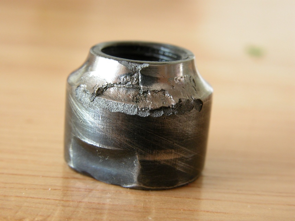 A photograph of a bicycle bearing damaged by a lack of lubrication.