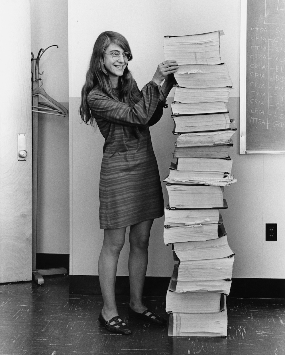A photograph of Margaret Hamilton and code that helped accomplish the Apollo 11 lunar landing.