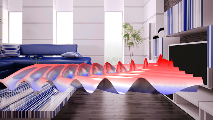 A virtually augmented living room, with a plot of the radiation pattern of a loudspeaker coming from a TV, visualized in reds and blues.