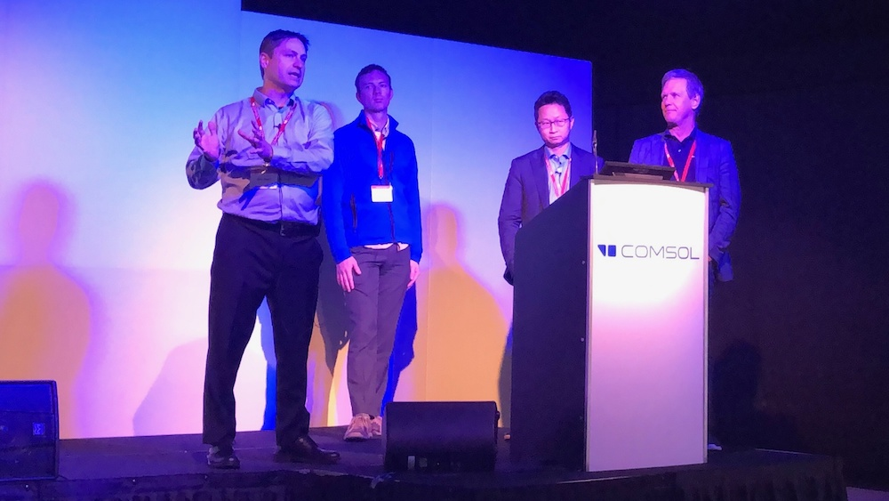 A photograph of Svante Littmarck, Bjorn Sjodin, Kristian E. Jensen, and Jiyoun Munn at the COMSOL Conference 2019 Cambridge.