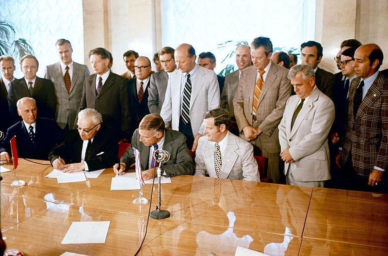 A photograph of Vladimir Kotelnikov signing the ASTP agreement.