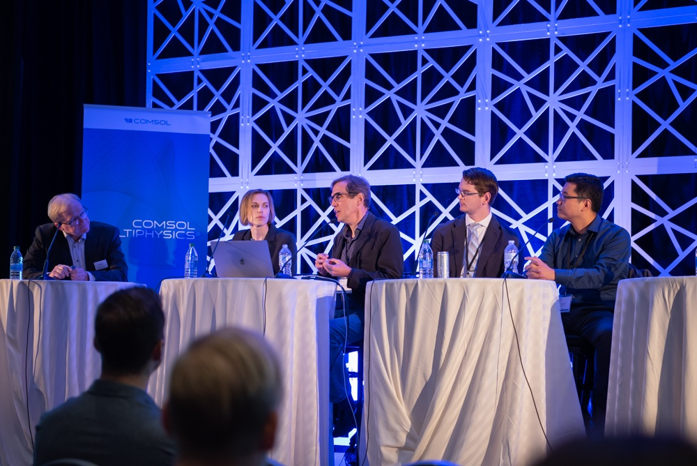 "Panelists discuss their photonics modeling work during the ""Frontiers of Modeling in Photonics Research"" panel."