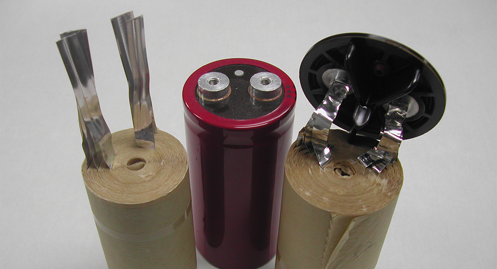 Three aluminum electrolytic capacitors.