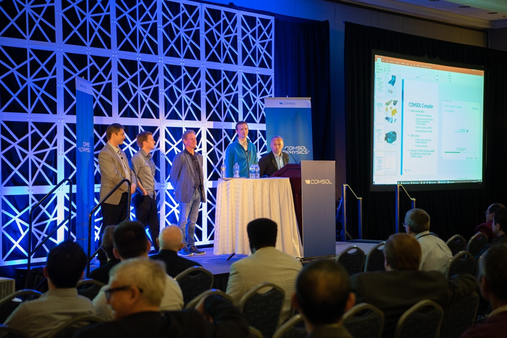 A photograph of COMSOL staff giving a keynote talk about an upcoming release.