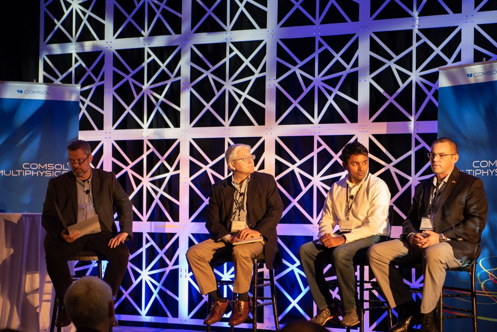 A photograph of the panel discussion on simulation applications at the COMSOL Conference.
