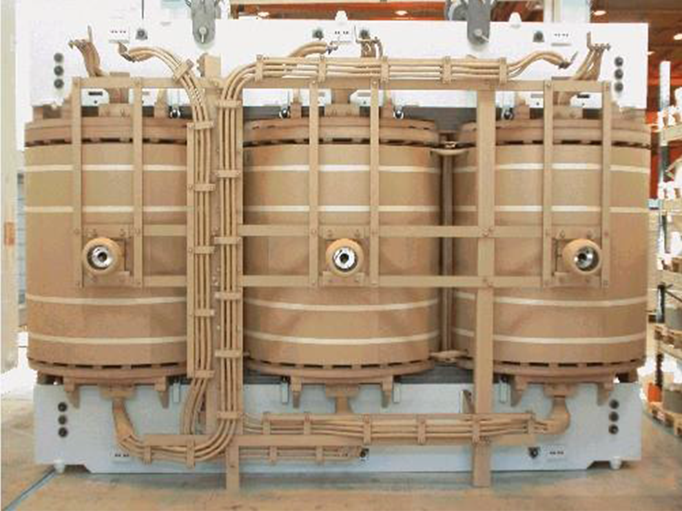 Three beige enclosed transformers.