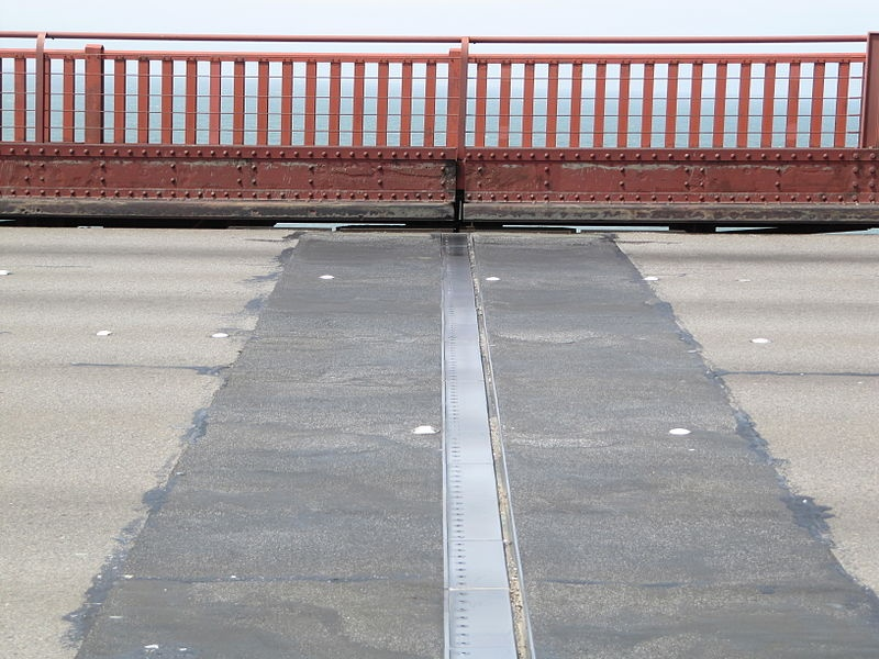 A photograph of an expansion joint on the Golden Gate Bridge, these joints gives bridges room to expand in cases of thermal expansion.