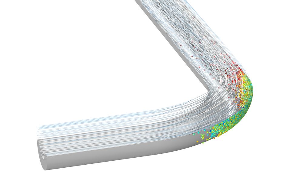 An image of a model showing particle flow in a pipe bend.