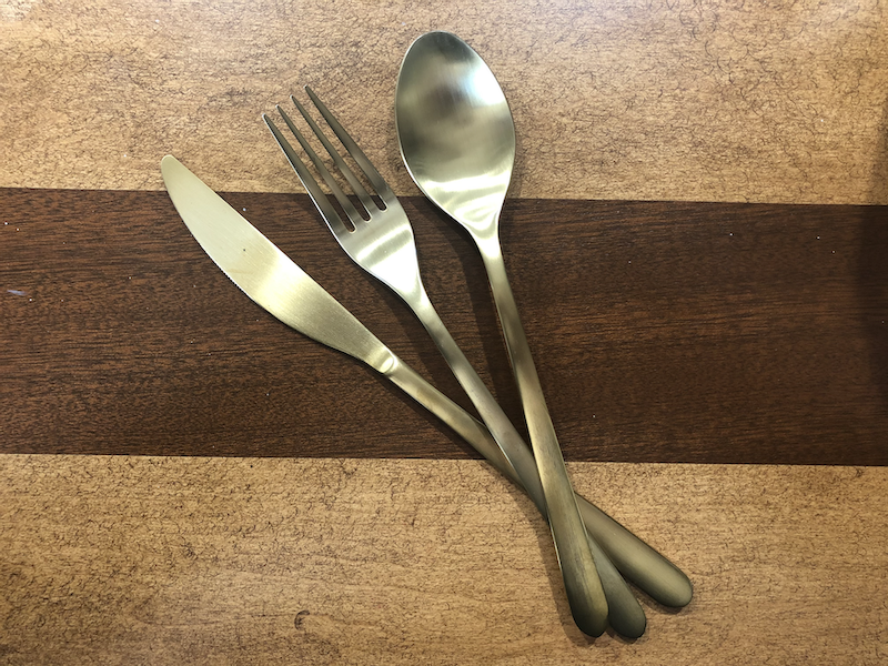 A photograph of a fork, knife, and spoon that have been electroplated.