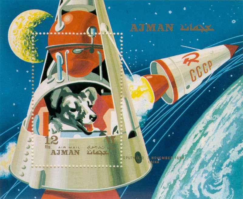 A colorful illustration of Laika the space dog on a Russian stamp.