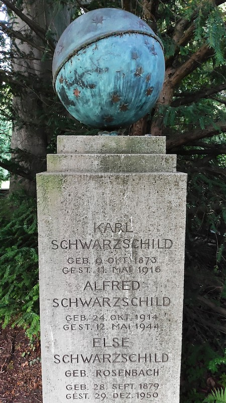 A photo of the tombstone of Karl Schwarzschild, which is topped with a large sphere and stars.