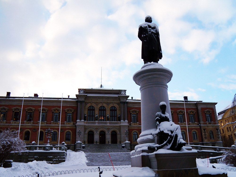 A photograph of the front of the main building of Uppsala University in Sweden.