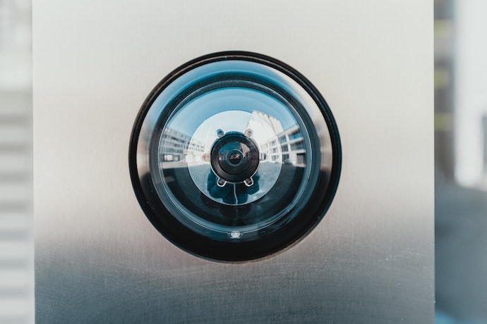 A photograph of a modern home security camera system.