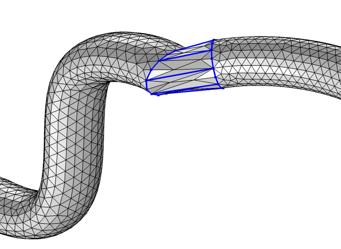 Two disconnected meshed pipes that are joined using the Create Faces operation.
