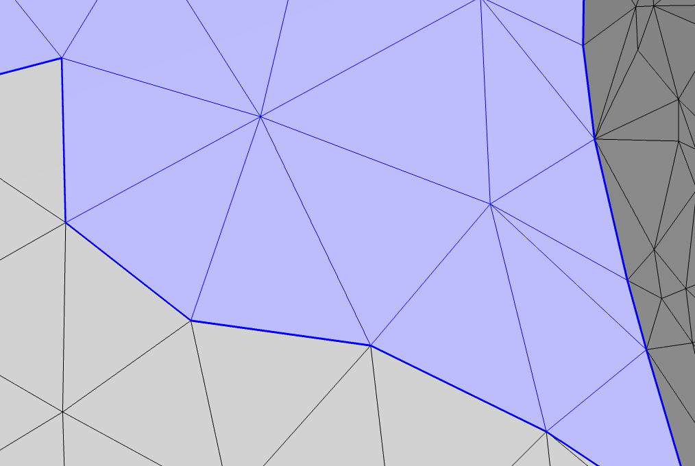 A close-up image of the meshed sphere after using the Partition with box operation, with the affected region highlighted in blue.