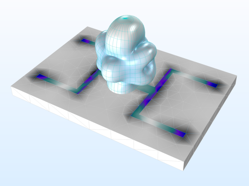 A printed dual-band strip antenna model visualized on a gray substrate with blue and green showing the electromagnetic phenomena.