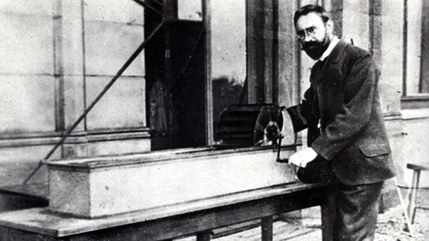 A black-and-white photograph of Ludwig Prandtl at his water channel in Gottingen, Germany.
