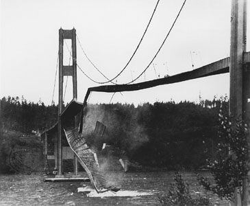 A black-and-white photo of the Tacoma Narrows Bridge collapse in 1940.