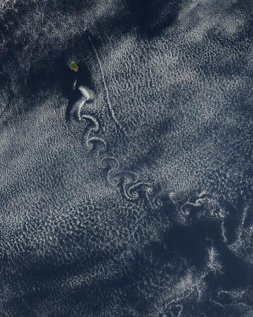 A satellite image of a Kármán vortex street in the ocean.