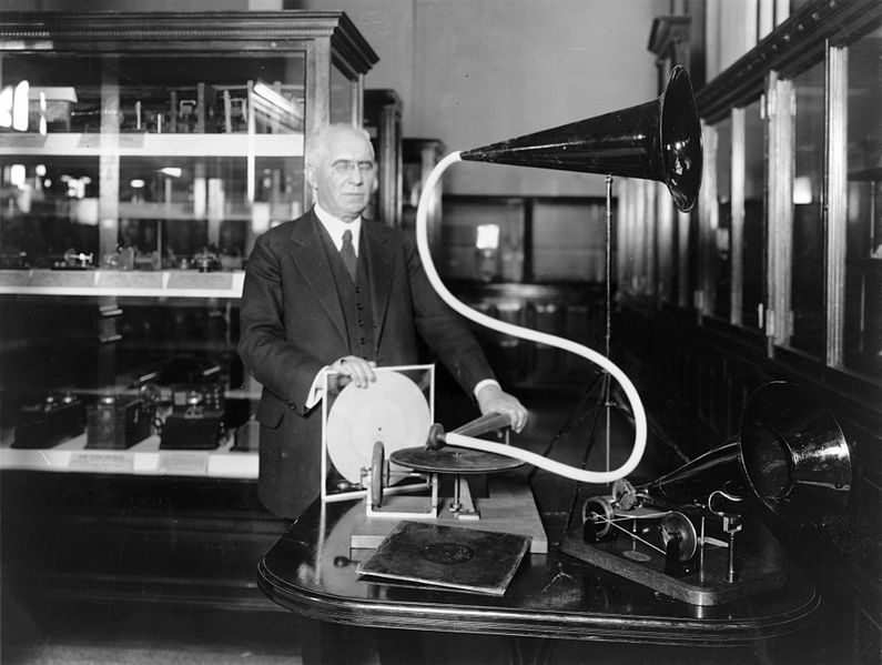 A black-and-white photograph of Emile Berliner with a gramophone.