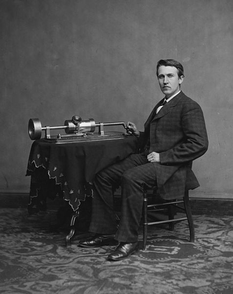 A black-and-white photograph of Thomas Edison with a phonograph.